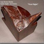 """First Flight"", red marble, stylized hawk"