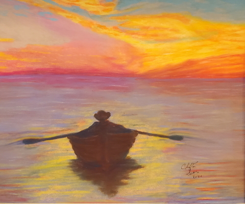 a fisherman rowing in with the sun setting behind him.