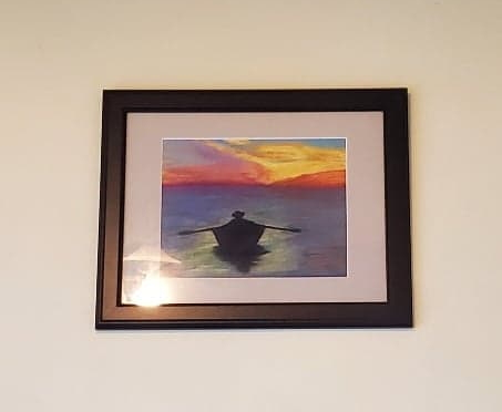 pastel painting of a fisherman rowing in at sunset