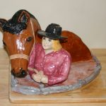 Girl with horse, a portrait figurine in ceramics