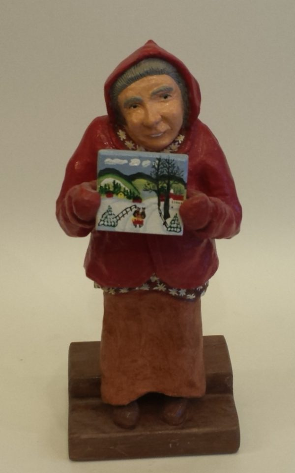 A small portrait carving of Maude Lewis