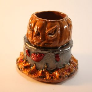 ceramic candle holder, evil pumpkin having a lobster boil